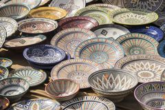 Porcelain, hand-painted dishes of a multitude of colors in a tra Stock Images
