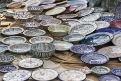 Porcelain, hand-painted dishes of a multitude of colors in a tra Stock Photography