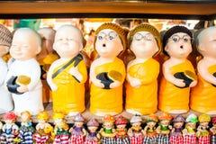 Porcelain happy little monk Stock Images