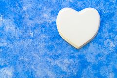 Porcelain heart on a sky blue background. Copy space. White porcelain heart on a sky blue background. Copy space royalty free stock photography
