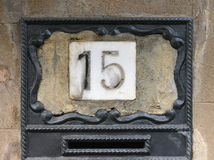 Porcelain house number fifteen Stock Photos