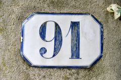 Porcelain house number ninety-one Royalty Free Stock Photos