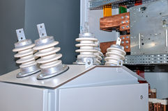 Porcelain insulators on the electric transformer Stock Photo
