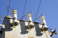 Porcelain insulators to phase step-down transformer Royalty Free Stock Image