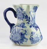 Porcelain jug. A porcelain jug on white background Royalty Free Stock Image