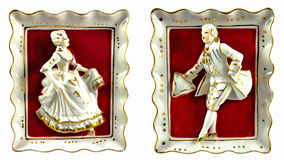 Porcelain lord and lady. In a porcelain frame on red felt Royalty Free Stock Image