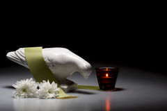 Porcelain mourning dove with white chrysanthemum and red candle Royalty Free Stock Photo