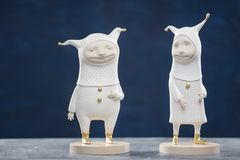 Porcelain paper mache clay statuette jesters. White beauty handmade handcrafted toy craft vintage golden decor doll gift texture concept Royalty Free Stock Photos