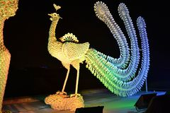 A porcelain phoenix. Is made up of porcelain plates,cups and spoons. It is a miraculous opus in the Lantern Festival of China royalty free stock photography