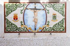Porcelain pieces mosaic background on wall in old town in Calpe. Royalty Free Stock Image