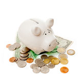 The porcelain pig with coins and banknotes Stock Photography