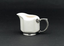 Porcelain pitcher Stock Images