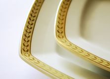 Porcelain plate. Empty white porcelain plate with gold pattern royalty free stock images