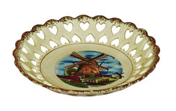 Antique porcelain plate for candy with a Dutch landscape isolate Stock Photos