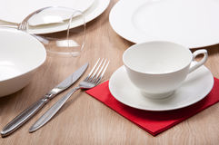 Porcelain plate on a dinner table Royalty Free Stock Image