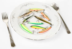 Porcelain plate with plastic fishing lures Stock Image