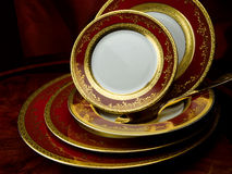 Porcelain plate set. Royal Gold Bordeaux Royalty Free Stock Photo