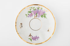 Porcelain plate on the white background. Top view Royalty Free Stock Images