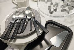 Porcelain Plates, Coffee Cup, Silverware and Cookie Cutters Stock Photo