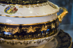 Porcelain pot with black and golden ornament Stock Image