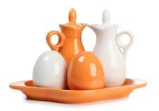 Porcelain salt. Porcelain jar and a salt shaker on white background Royalty Free Stock Image