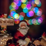 Porcelain Santa Claus figurine in front of a Christmas tree stock photos