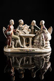 Porcelain sculpture of people playing cards Royalty Free Stock Image