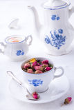 Porcelain set with tea from roses stock photography