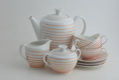 Porcelain set on the white background. Porcelain coffee set isolated on the white and ready to have coffee break Stock Image