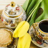 Porcelain set with yellow tulip flowers and cake Royalty Free Stock Photography