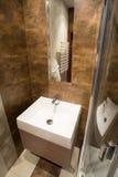 Porcelain sink inside small bathroom Royalty Free Stock Photo
