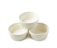 Porcelain souffle ramekin dish isolated. Pile of multiple white porcelain souffle ramekin dishes isolated over the white background Stock Images