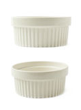 Porcelain souffle ramekin dish isolated. White porcelain souffle ramekin dish isolated over the white background, set of two different foreshortenings Stock Photography