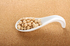 Porcelain spoon with seeds chickpeas Royalty Free Stock Image