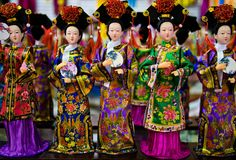 Porcelain statues worn with popular clothing in China Royalty Free Stock Photography