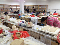Porcelain studio. Many Crafters working in porcelain studio of the Jingdezhen Academy of Pottery and Porcelain Stock Image