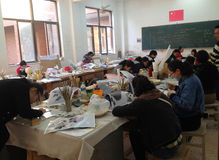 Porcelain studio. Many Crafters working in porcelain studio of the Jingdezhen Academy of Pottery and Porcelain Royalty Free Stock Photography