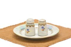 Porcelain tableware for salt and pepper on sacking Royalty Free Stock Photo