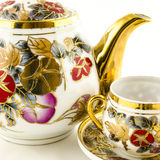 Porcelain tea and coffee set with flower motif on white Stock Photos
