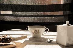 Porcelain tea cup, at breakfast time on the table Stock Image