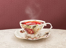 Porcelain tea cup with clipping path. Teacup lying on the table, the path is made for easy use Stock Photography