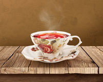 Porcelain tea cup over wooden table with clipping. Teacup standing on a wooden table, path is made for easy use Stock Images