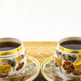 Porcelain tea cups with flower motif Royalty Free Stock Images