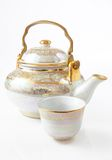 Porcelain tea pot. And cup on white background Stock Images