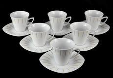 Porcelain tea set. White porcelain tea set on a black background royalty free stock photography