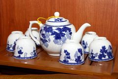 Porcelain tea set on wooden tray Royalty Free Stock Photos