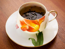Porcelain teacup and saucer Stock Images