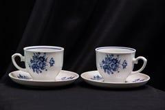 Porcelain teacups. On black cloth background Royalty Free Stock Photos