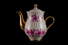 Porcelain teapot. On a black background Stock Image