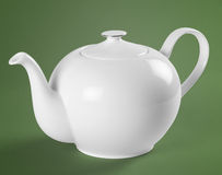 Porcelain teapot with clipping path. Green and white teapot standing on the floor Stock Image